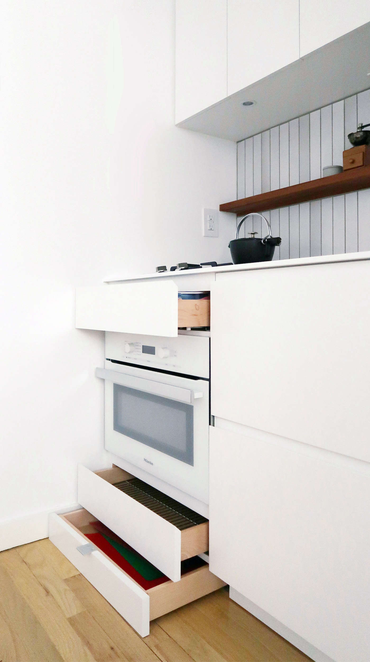 A small Miele speed oven—a combination microwave and convection oven—leaves room for drawers both above and below.
