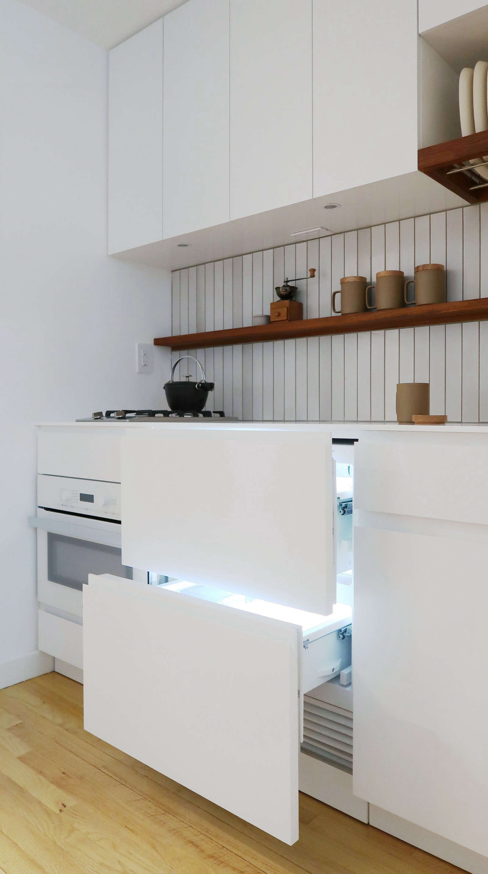 In the center of the kitchen is a 27-inch refrigerator drawer unit from Sub-Zero, with matching cabinet fronts.