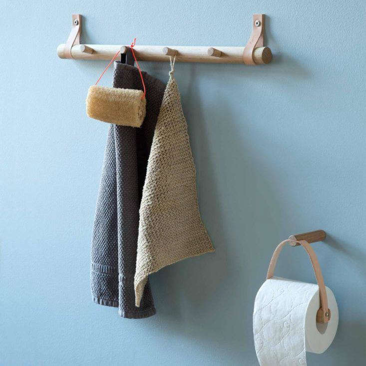 Oak hook rack and leather and oak toilet roll holder from By Wirth, Denmark.