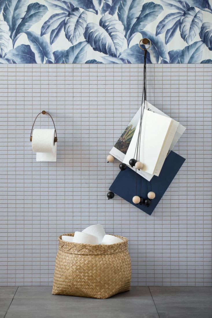 Leather and oak toilet roll holder and magazine hanger from By Wirth of Denmark.