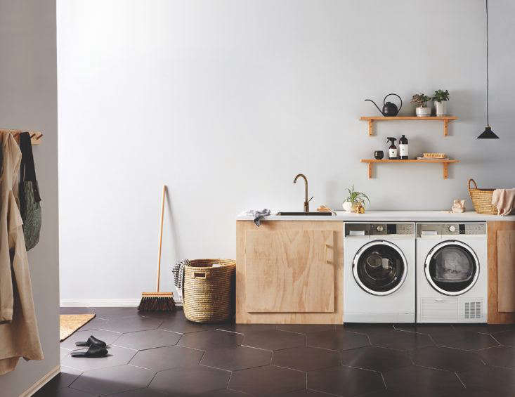 Combination laundry and mudroom room by Homestyle magazine, New Zealand. Fisher-Paykel washer/dryer.