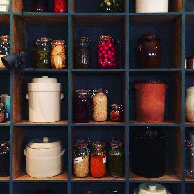 """""""These shelves are made from old pine cheese boards from Holland,"""" explains Lattin, who found them at theArdingly International Antiques & Collectables Fair and then waxed and painted them."""