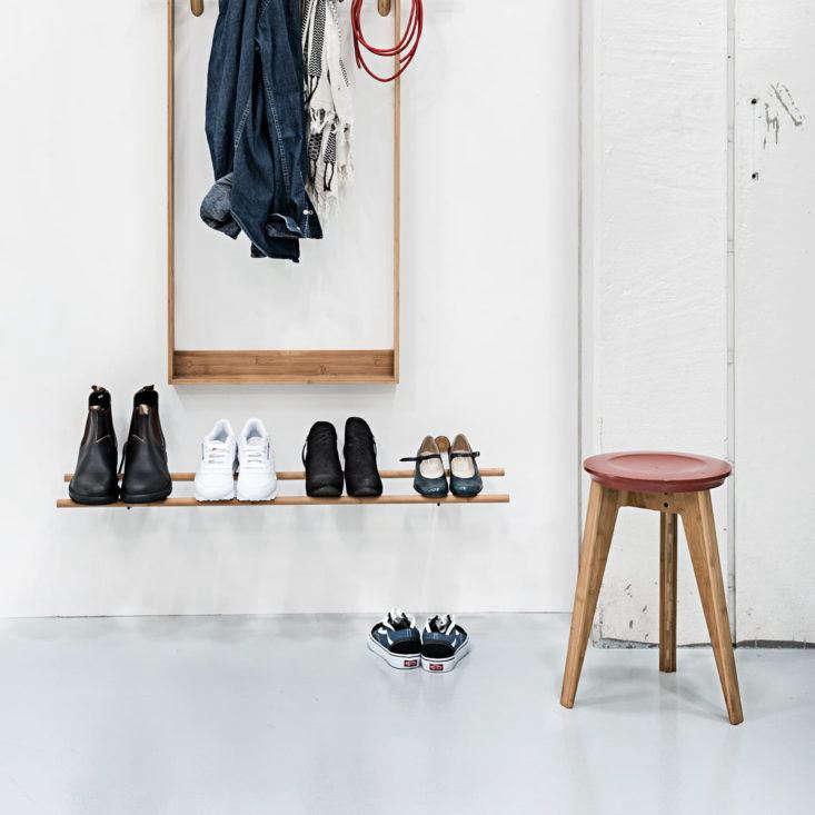 For a household's worth of shoes, install several wall-mounted Shoe Racks from Danish brand We Do Wood, made of bamboo and brass; $180 at Connox.