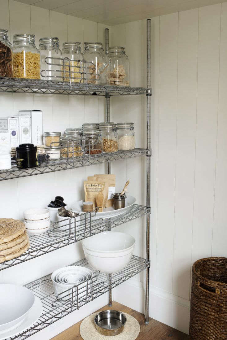 Barbara's kitchen pantry is tidy and light-filled, with most dry goods decanted into jars.