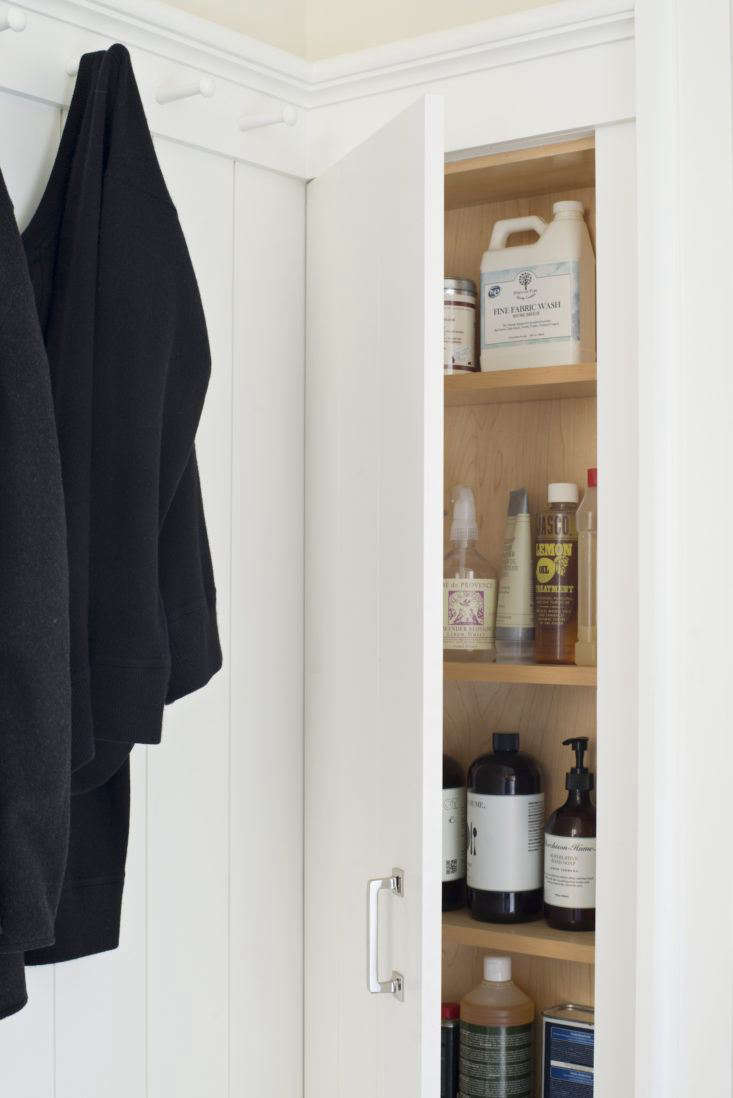 """You'll need to plan for this one during a remodel or new build, says Barbara, but there's room behind the walls for shelves, hooks, ironing boards, and more. """"Just slip in little cabinets inside the stud wall, and all of a sudden you have a lot more space,"""" she says. Barbara uses one such stud wall cabinet to store laundry and cleaning essentials."""