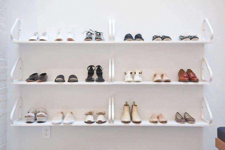 An idea we love. At women's clothing store La Garçonne in SoHo, New York City, architect Solveig Fernlund used a trio of Alvar Aalto Wall Shelves to display shoes. These shelves are as lovely as any we know (they're $495 each in white from Hive Modern), but Ekby shelvingfrom Ikea (at $14.99 each) would do the trick. See the rest inSensuous Simplicity for the Thinking Woman.Photograph by Michael A. Muller for Remodelista.