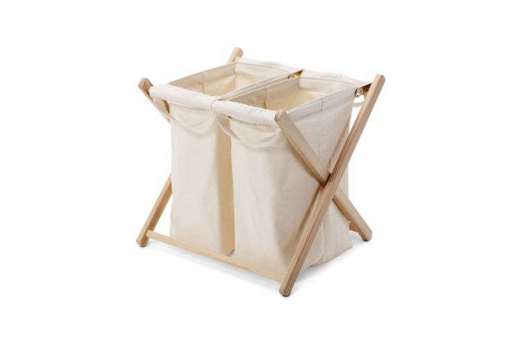 Made in northwestern Germany, Manufactum'sDouble Washing Bag features cotton laundry bags that hang from a larch wood crisscross frame; €97. There are single- and triple-bag versions as well.