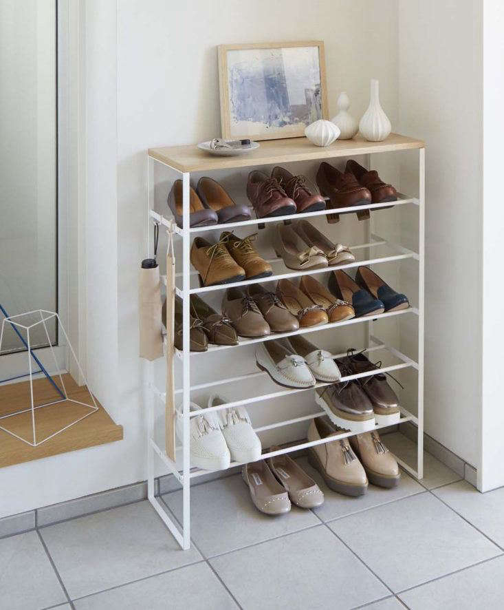 ThisTower Shoe Rack accommodates six rows of shoe storage (up to 24 pairs of shoes) and has a solid wood top for resting keys, mail, and other entryway essentials. It's made in Japan by Yamazaki of powder-coated steel and wood;$115.50 at Burke Decor. See more Yamazaki products here: 10 Ingenious (and Inexpensive!) Small Storage Products from Japan.