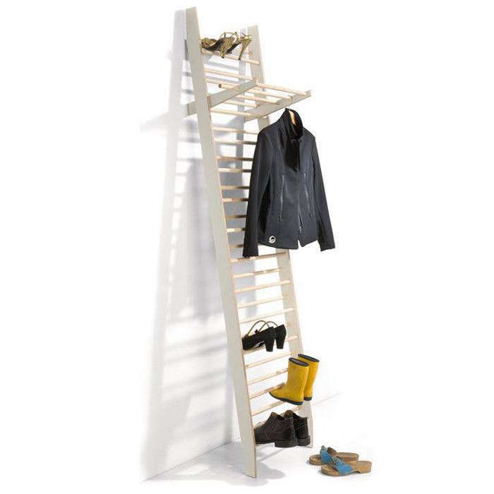 The ladder-style Shoe Rack Attendant fromGerman brand Magazin leans against the wall, holding up to 26 pairs of shoes. An included garment hanger rests on any rung to allow for extra hanging storage. Made of birch and ash wood, it's €325.