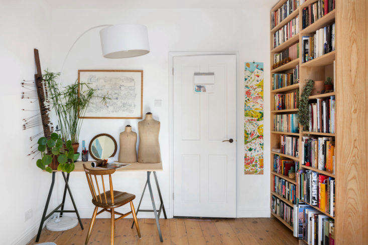 Front door in a small space London apartment with desk and bookshelf