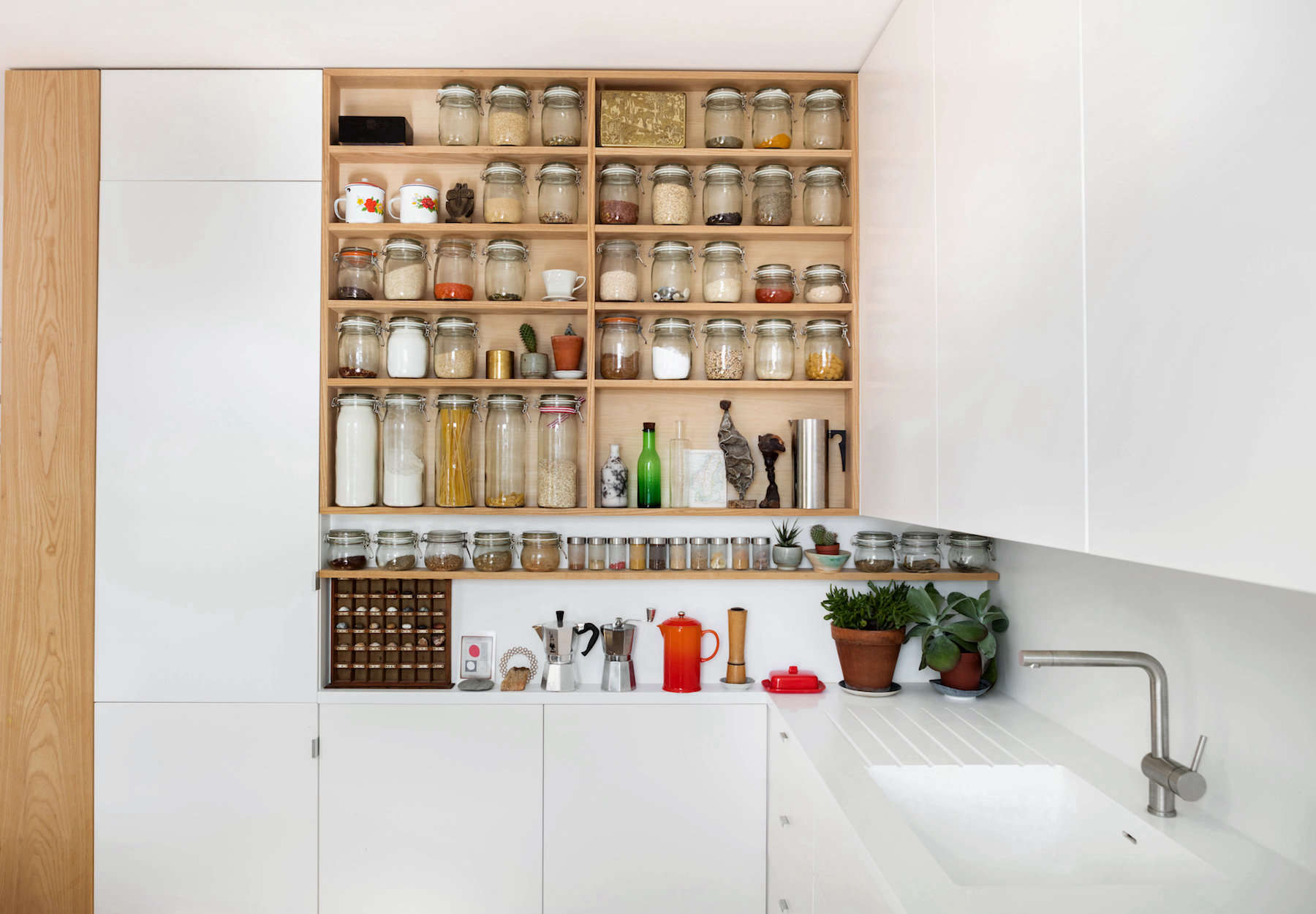In addition to the open pantry that was DIY'd by the homeowners using ash wood, they managed to fit two Ikea wall cabinets on top of each other to the left of it, and turn the leftover space above into a cabinet of its own. See Tricks of the Trade: 7 Small-Space Storage Tips from Emil Eve Architects. Photograph by Mariell Lind Hansen, courtesy of Emil Eve.