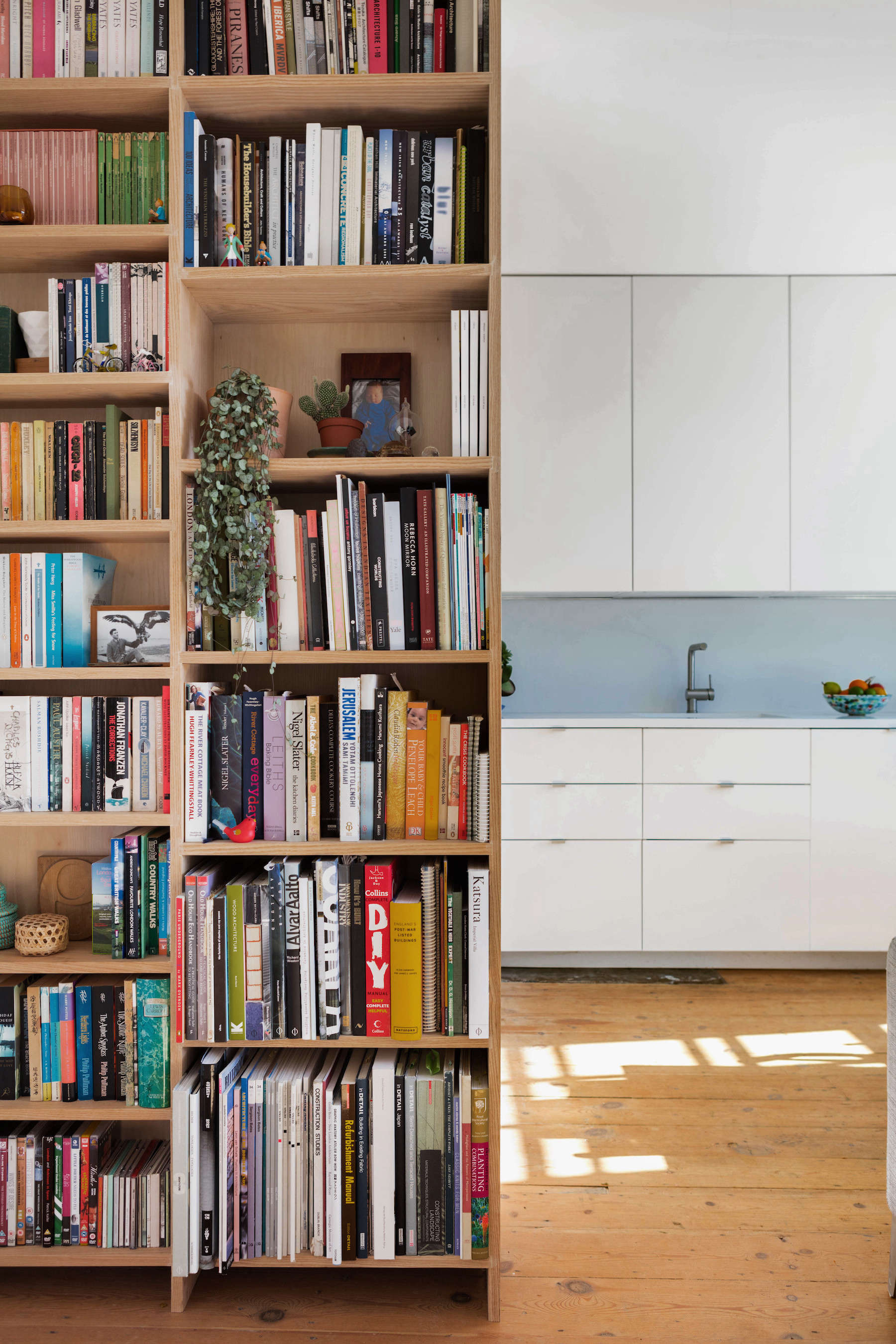 Built-in wood bookcase in London remodeled apartment