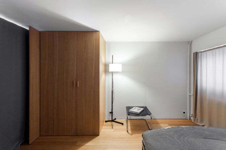 Bedroom with Curtain in Moscow Apartment by Studio Bazi