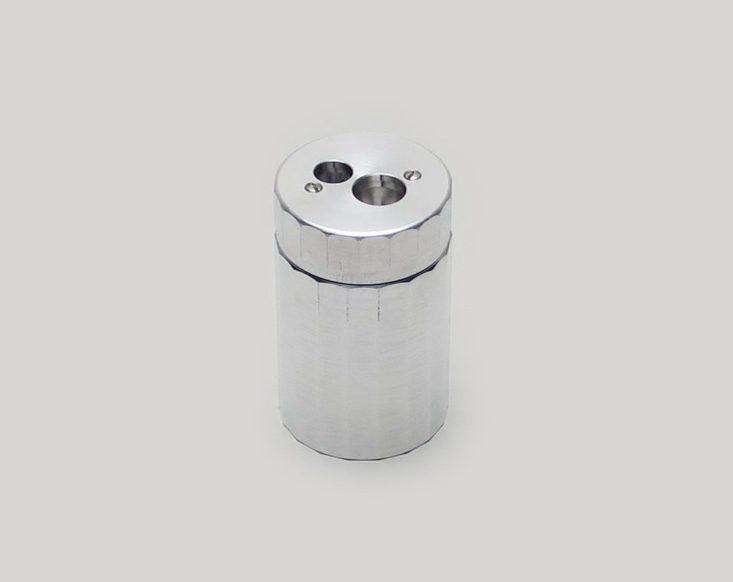 Dux aluminum pencil sharpener.