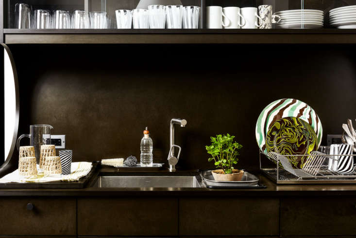 """Be sure to empty the dishwasher an dish rack before guests arrive. """"I keep a mesh basket in the secondary sink…and use it as an extra drainboard,"""" says Stark. PhotographbyHeidi's Bridgefor Remodelista, fromKitchen of the Week: 11 Genius Ideas to Steal from David Stark's Brooklyn Heights Kitchen."""