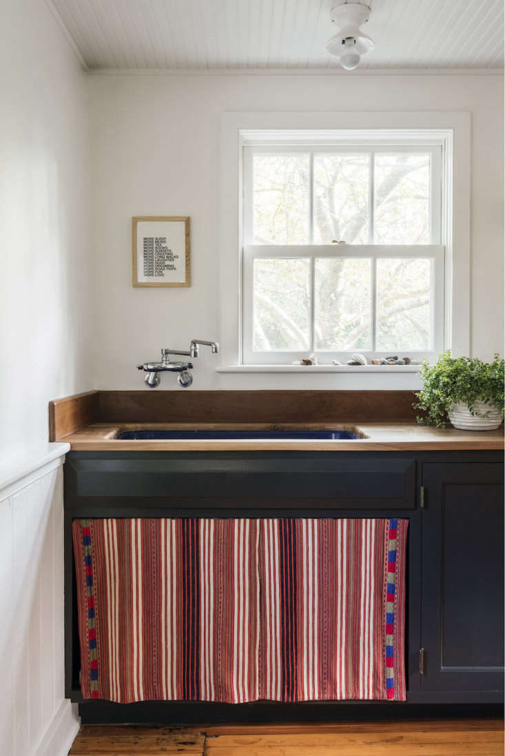A Remodelista favorite, Elizabeth Robertshad a sink skirt sewn froma vintage Guatemalan textile for her beach house. SeeElizabeth Roberts at Home: The Architect's Own Beach House in Bellport, NY.Photography byDustin AkslandandEric Striffler, courtesy of Elizabeth Roberts.