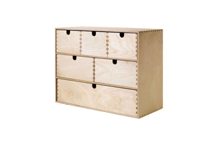 Ikea's http://Moppe mini storage chest is made of birch plywood with fiberboard backing, and is just over 16 inches wide by one foot tall and seven inches deep. It comes untreated, so can be finished with a wax, stain, paint, or oil of your choice; $19.99.
