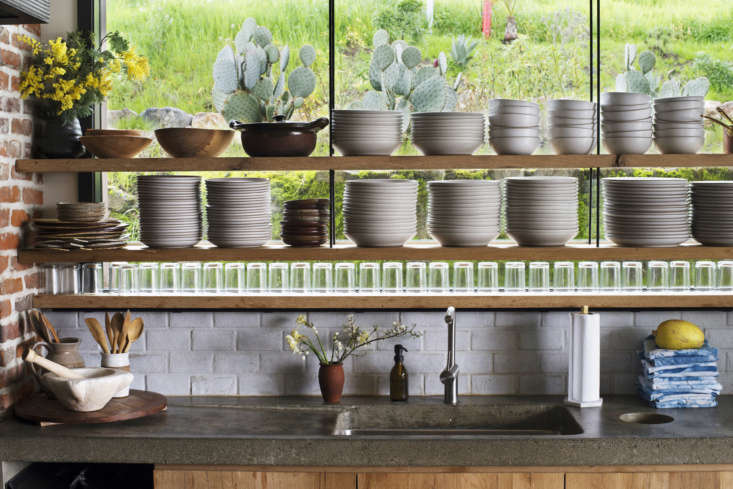 The custom concrete countertop in Scribe Winery's hacienda kitchen includes a cutout hole for food scraps. Photograph by Andres Gonzalez for Remodelista, from Kitchen of the Week: A Hacienda Kitchen in Sonoma's Hippest Winery.