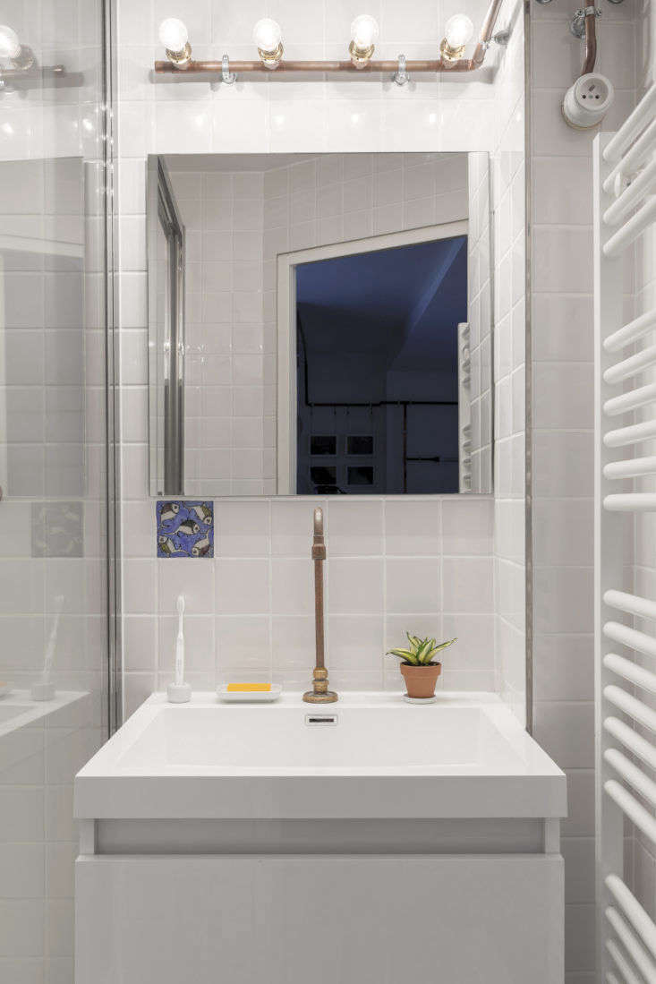 Bathroom with Copper Pipes in Shaker Studio Airbnb in Paris by Ariel Claudet, Photo by Cyrille Lallement