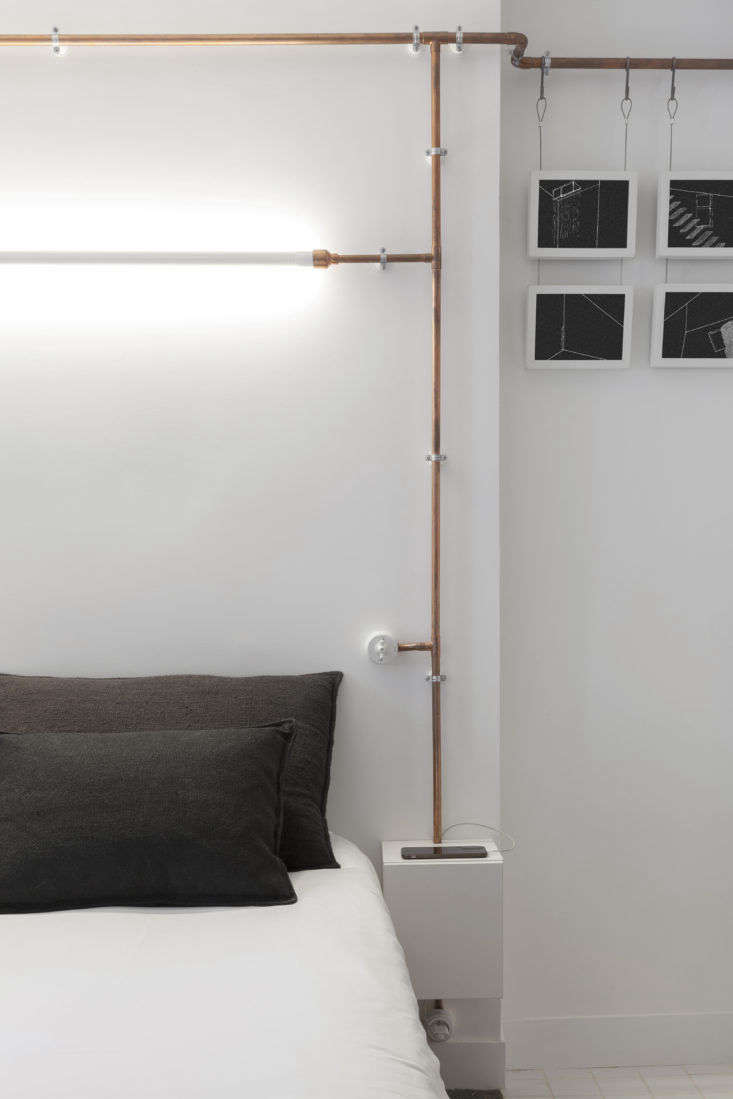 Bedroom with Copper Pipes in Shaker Studio Airbnb in Paris by Ariel Claudet, Photo by Cyrille Lallement