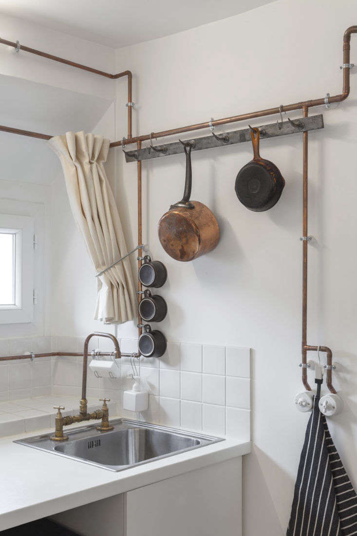 Kitchen with Copper Pipes in Shaker Studio Airbnb in Paris by Ariel Claudet, Photo by Cyrille Lallement