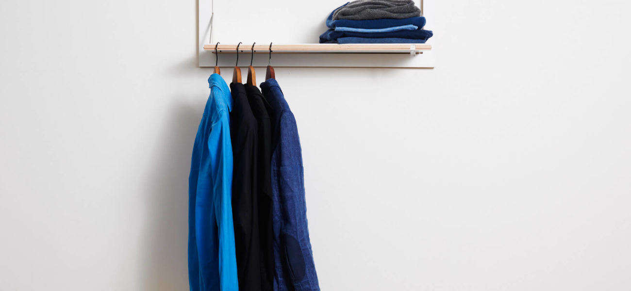Flapps by Ambivalenz fold-down shelf and clothes hanger.