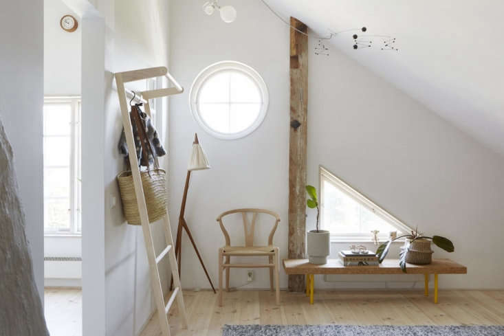 We really, really love this ladder storage rack fromFor Sale in Sweden: A Scandi Modern Flat in a Lakeside Chalet.