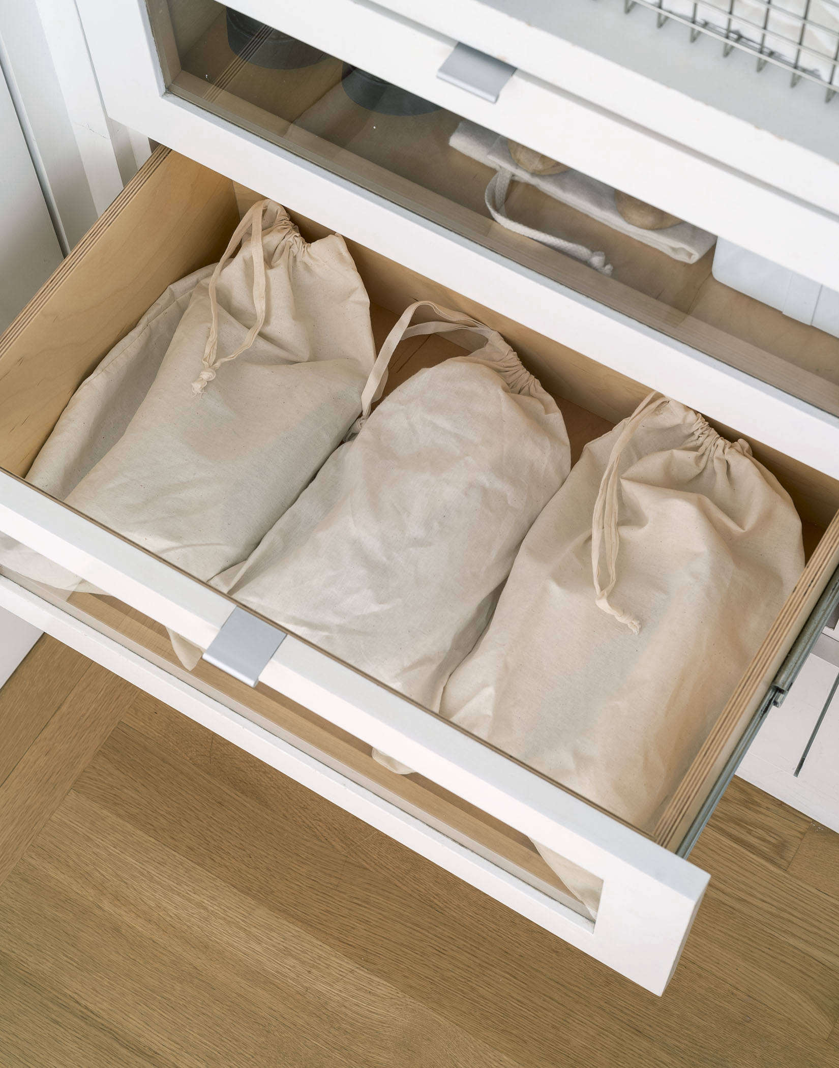 Organized Home Canvas Shoe Bags Photo by Matthew Williams Styling Alexa Hotz