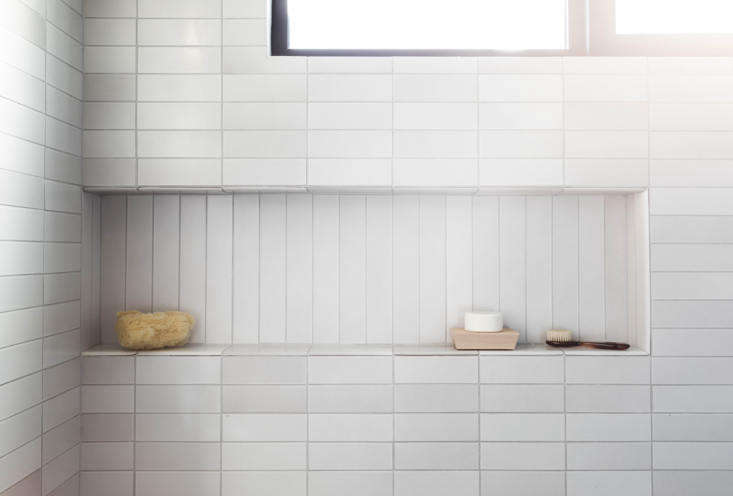 The vertical tiles in this niche are a nice contrast to the horizontal tiles around it.Photograph byLaure Joliet, courtesy of Tamar Barnoon, fromBathroom of the Week: In LA, a Softer Take on Black and White.