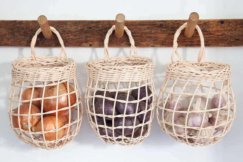 Sugar Tools' Onion Baskets are handmade in Maine from rattan. The loose weave allows for proper air flow and discourages moisture and mold. They measure 9.5 inches tall (including handle); $28 each.