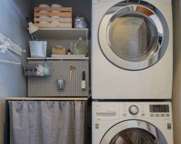 If you have a stacked washer and dryer, you may end up with room to spare in your laundry closet. Here, Meredith added a pegboard and open shelving for extra storage, a countertop for a laundry-folding surface, and a curtain around it to conceal a kitty litter underneath. See the details of her DIY project inBefore & After: A Pet-Friendly Overhaul for the Laundry Closet. Photograph byMahyar Abousaeedifor Remodelista.