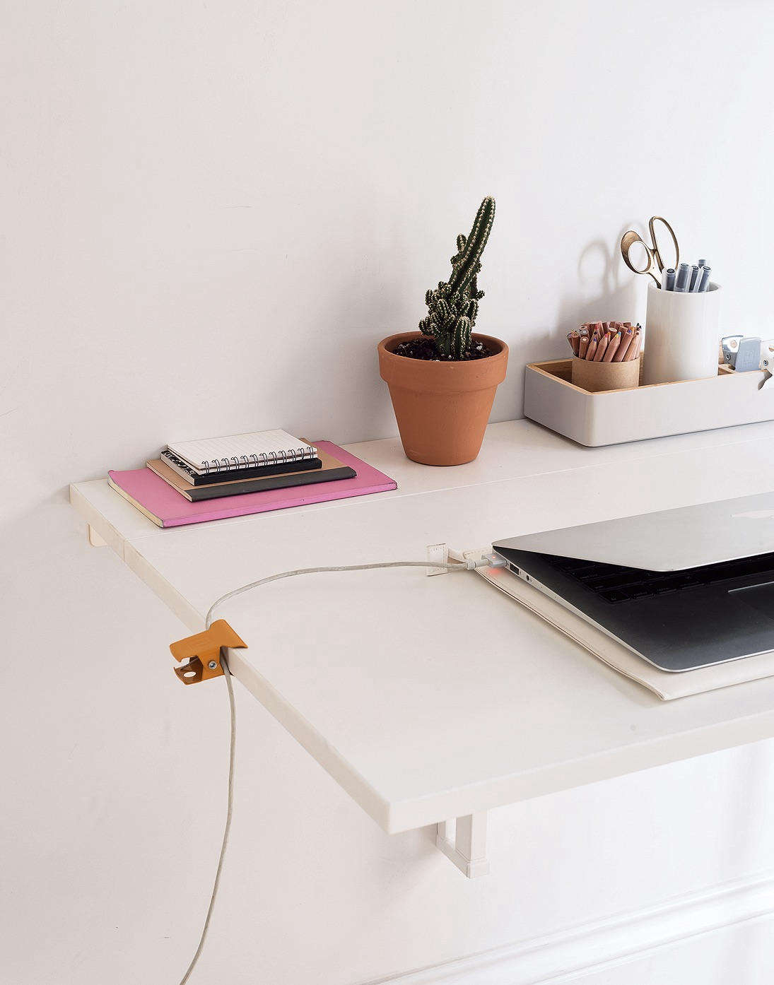 Binder Clip on Disappearing Desk in Organized Home Book, Image by Matthew Williams