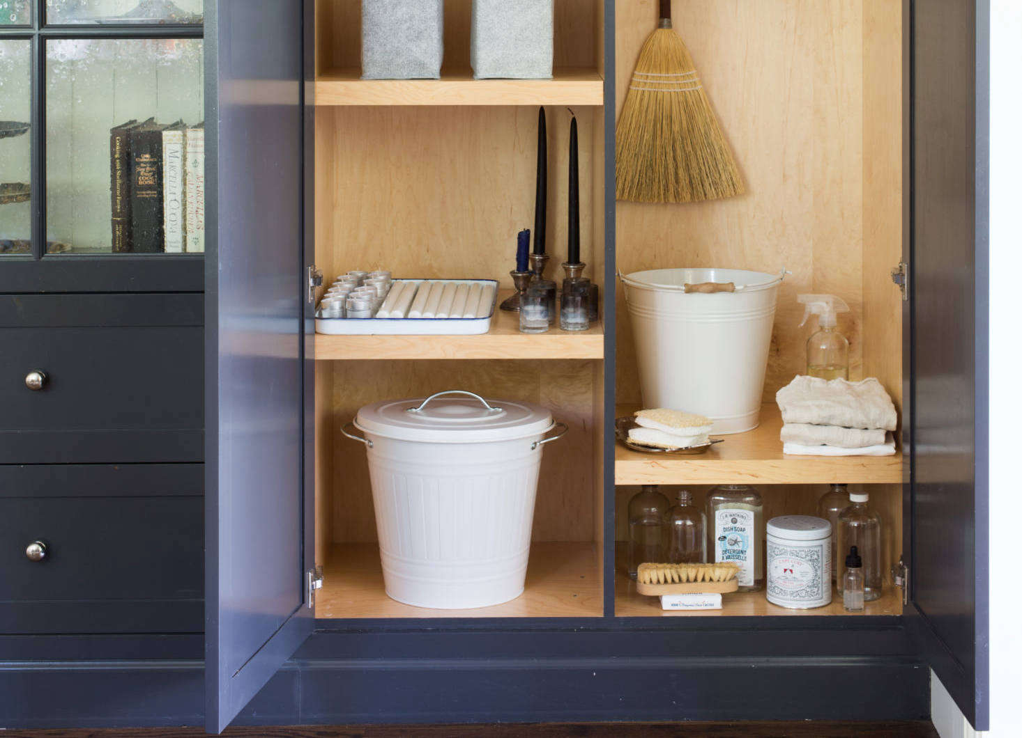 In Michelle's utility closet, a Knodd Bin, in white, holds pet food; $14.99. (SeeWhat's Inside: The Stealth Utility Closet.)