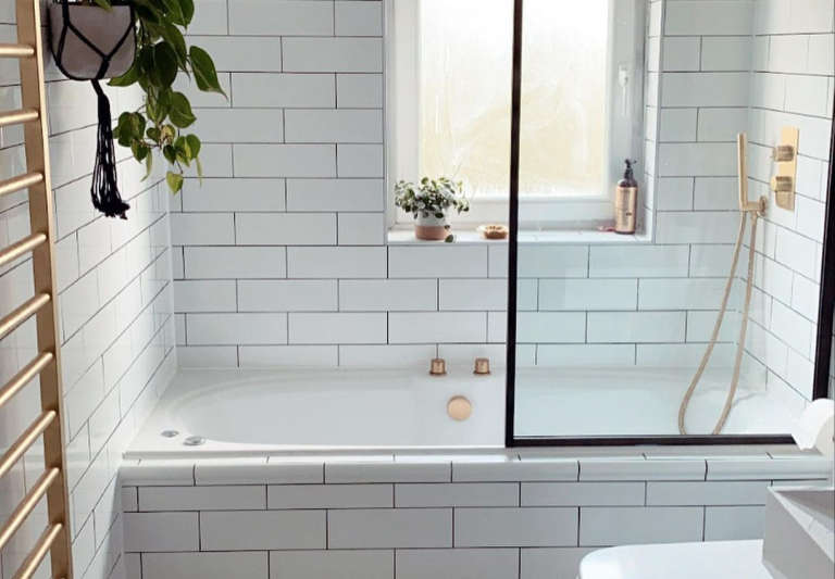 Ferren Gipson's white-tiled bathroom remodel, London.