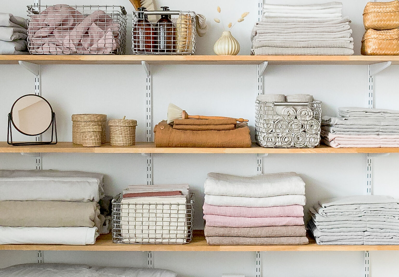 Linen closet goals: shelves with Korbo metal baskets.