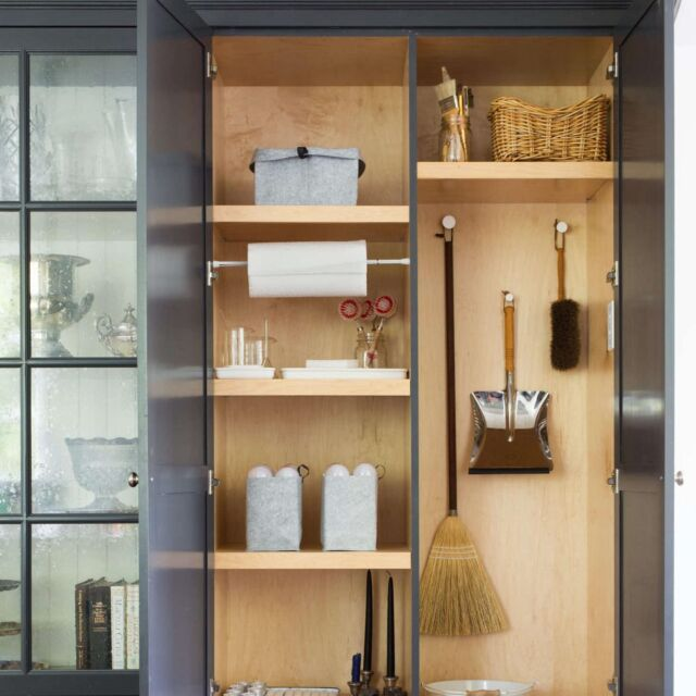 If possible, hide the utility closet in plain sight in the kitchen, where you need it most. During a recent remodel, Michelle Slatalla's kitchen got a wall of built-in storage including a stealth utility closet, hidden behind two discreet paneled doors. You'd never know it is there – until someone spills, drips, drops, or breaks something on the floor. Then it's utility closet to the rescue. Photography by Mimi Giboin.