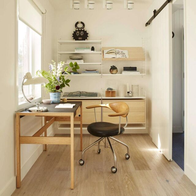 In the recent past, many households have prioritized the home office, converting odd spaces into something semi-quiet and functional enough to work in. A great example? The closet-sized office designed by Ellen Hamilton as part of a 1970s beach cottage renovation in Chilmark, Massachusetts. An entry hall gives way to a clean, Scandinavian-style office through a sliding barn door. Photograph by Max Kim Bee, courtesy of Ellen Hamilton.