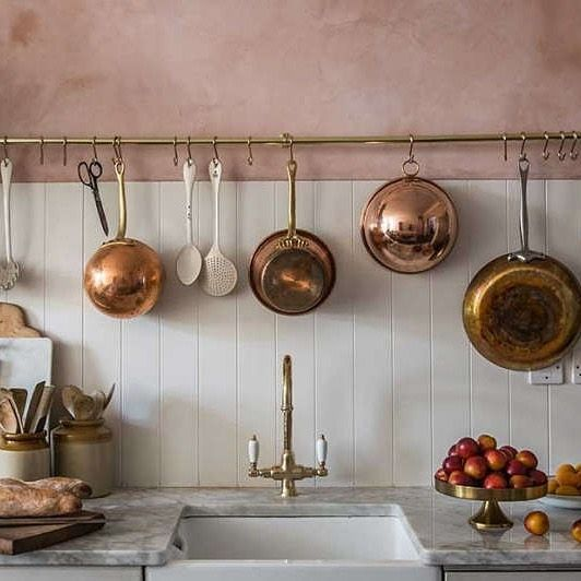 There are so many reasons to consider open storage in the kitchen: Having your essentials out in the open discourages hoarding tendencies; it makes cooking easier when everything is accessible and visible; it can be a great way to display pretty tools; and it's both a classic look (think Julia Childs and her pegboard of pots and pans) and an au courant trend. But if those arguments for open storage don't sway you, how about this? If you're planning a kitchen remodel, mounting open shelves, doorless cupboards, a utensils rail, or a pot rack is much less expensive than having a full wall of cabinets with doors built and installed. Photograph and styling by Skye McAlpine.