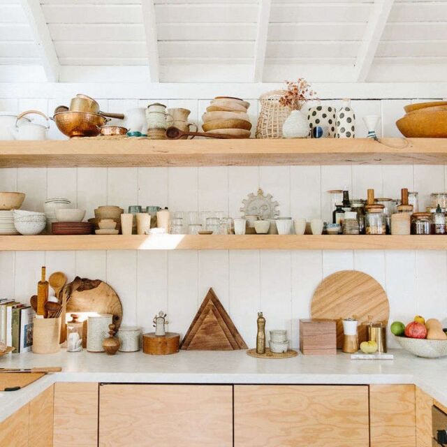 This is what most people envision when they talk about open storage in the kitchen. Keep in mind that there are many different ways to have open shelving: Mount a few planks, one above the other, or simply install one long plank. And you can apply the look to an entire wall, or just a corner. Photograph by Nicki Sebastian, courtesy of Rip & Tan.