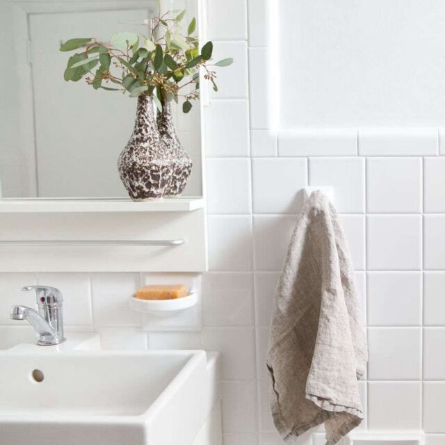 """To keep caulk and grout looking clean and mildew-free, #OrganizedHome editor Annie applies a baking soda paste. """"Make a poultice of baking soda and water to clean pesky mildew from shower caulk and grout,"""" says Annie. """"Mix it up (a few tablespoons of baking soda, and just a bit of water for a pretty thick paste); smear it on (I like to use an old toothbrush—it's small and perfect for nooks and crannies); and let it sit for a half hour or so. Then, scrub with the toothbrush and rinse! It's particularly useful for the ring of caulk around the edge of the tub."""" Photograph by Sarah Elliott."""